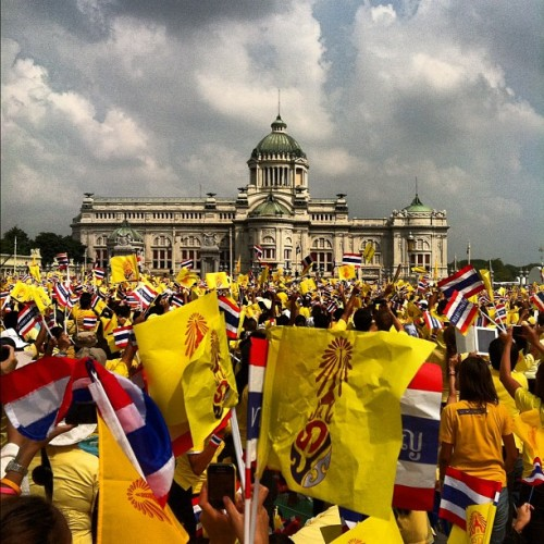 instagram:  Thailand Celebrates King Bhumibol Adulyadej's 85th Birthday  To see more of the festivites in Thailand, visit photos posted from the Royal Plaza (ลานพระบรมรูปทรงม้า) in Bangkok.  Bhumibol Adulyadej, Thailand's king and the world's longest-serving head of state, turns 85 years old today. King Bhumibol, also known as Rama IX, has ruled Thailand for more than 66 years, and is a popular figure throughout the country.  Many Thais, clad in yellow—a color symbolizing devotion to the monarch—have camped for days at the Royal Plaza in anticipation of the day's festivities, which include fireworks, thousands of vividly colored marigolds, and a performance by Korean pop singer Psy.