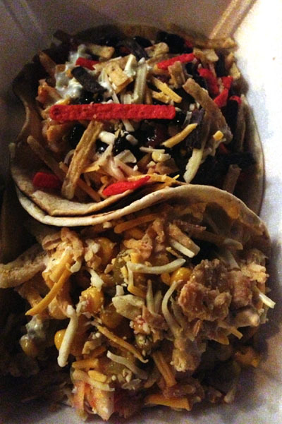 Beef and Chicken Tacos from Fired Up Taco Truck in Cleveland, Ohio The beef (up top) was good… but the combo of the chipotle aioli, a corn/green chili salsa, and the crispy fried onions on the chicken taco (on the bottom) were out of this world. Pretty much a dream taco for me. They park weekly at the Mini Mart in Lakewood for Taco Tuesday, and make other stops around the city on a regular basis. Check out their Twitter feed for upcoming locations.