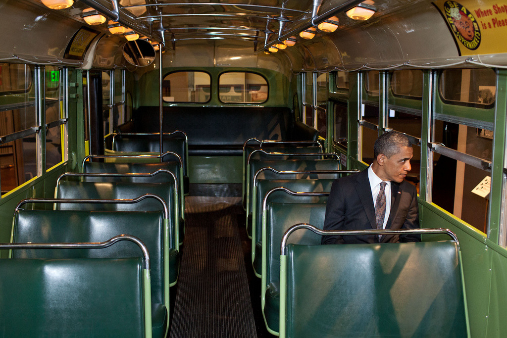 barackobama:  One of our favorite photos from this year: President Obama sits on the Rosa Parks bus at the Henry Ford Museum in Dearborn, Michigan.