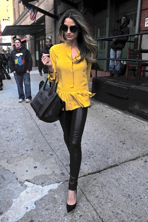 fashionbygettyimages:  Fashion model Lily Aldridge spotted on the streets of NYC wearing a mustard top & leather leggings. Source: filmmagic.com
