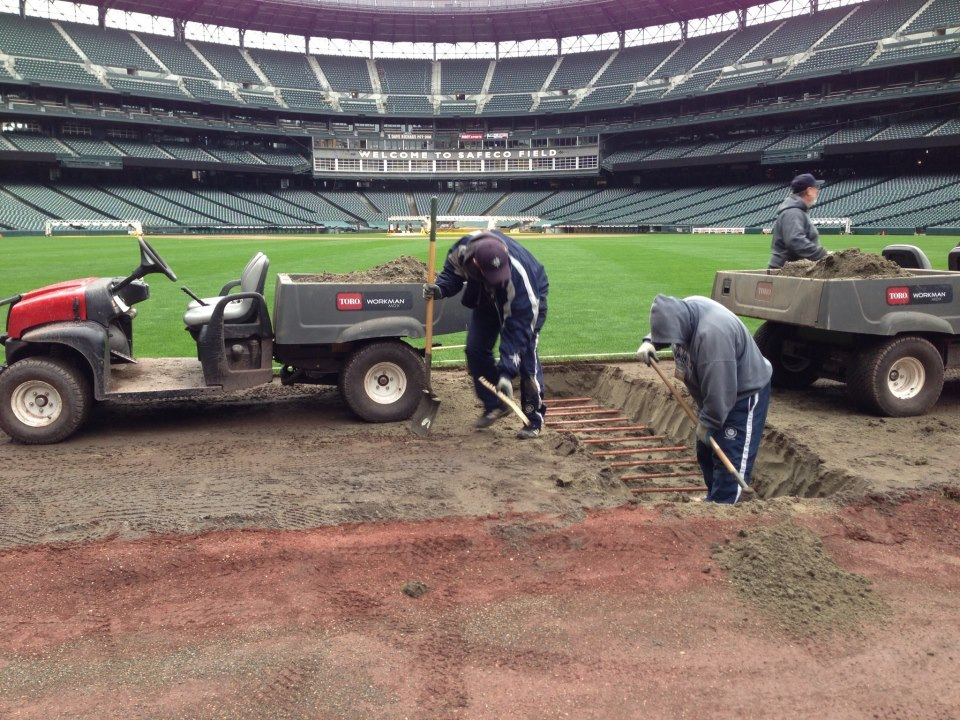 Safeco Field grounds crew digging up sprinklers ready for the fences to come in. Source: Mariners' Facebook page.