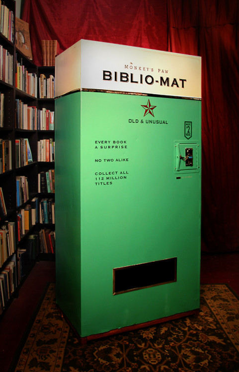 "bookshelfporn:  This Vintage-Looking Vending Machine Dispenses Rare Books For Just $2 A Toronto bookstore has come up with a creative way to add value to old, discount books that otherwise may clutter its storage: an antique-seeming ""book dispenser"" that randomly spits out old books for $2 a pop. The Biblio-Mat combines the charm of a gumball machine with the surprise element of a raffle. The machine jumps to life once money's inserted. With a bit of overt drama—cranking and whirring and ringing that invoke old machinery—the dispenser then releases a used title from its stock, dropping it into a slot for a happy reader to walk away with. (via Fast Company + infoneer-pulse)  So cool!!"