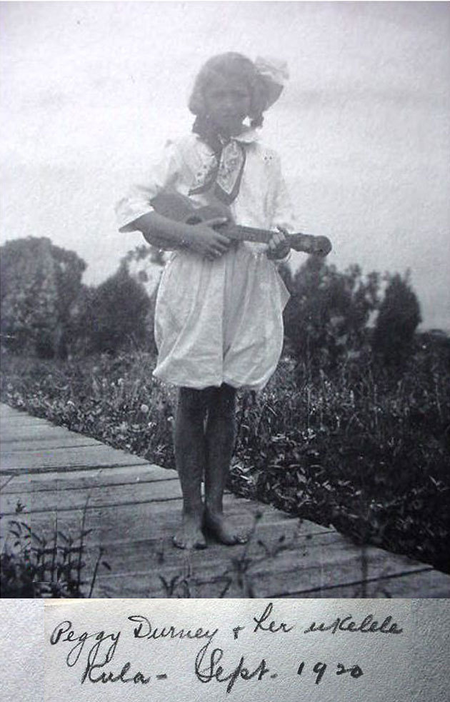 Peggy and her ukulele - 1920 From days long ago, Peggy Durney stands holding her ukulele in Kula, Hawaii.