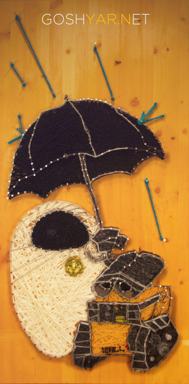 Pixar's Wall-E and Eve under an umbrella. yarn artist: Gino Roy