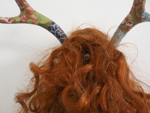 Monica, red wig, deer antlers and wall paper.  Yacine Naciri 2012