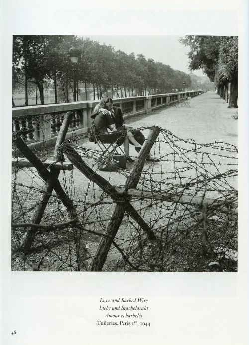 greatestgeneration:  Love and Barbed Wire by Robert Dosineau. Paris, 1944.