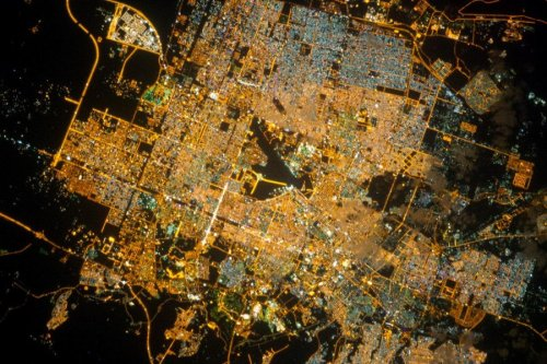 Holiday calendar: Riyadh at night (Photo: NASA / JSC)   Saudi Arabia's capital city glitters in this picture-perfect night view captured from Earth orbit last month from the International Space Station. The spread of Riyadh's city lights hints at a bustling population, which has grown from 150,000 in 1960 to 5.4 million this year. Click on over to NASA's Earth Observatory to identify landmarks such as the Riyadh Air Base, universities and the financial district. Read the complete story.