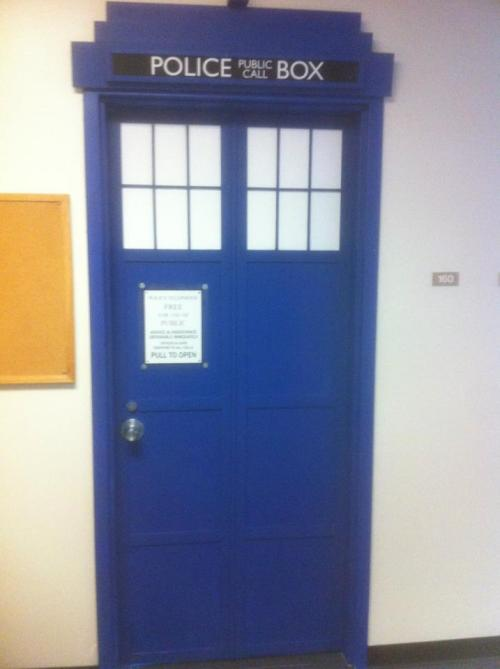 Doctor Who fans, I need your help. At Texas A&M University-Commerce a professor named Dr. Herndon and he painted his door like a Tardis and now the school is trying to take it away because supposedly the police sign will make people think that there are actually police in his office. The school hasn't taken it down yet because people like it, but we think they will over Christmas break unless we can get enough likes on the facebook page.  Please guys, go and like the facebook page and if you want leave positive comments about the door.