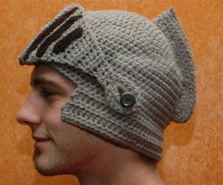 laughingsquid:  Hand Crocheted Knight Helmet Hat With Button-On Movable Visor  There are so many crocheted things I want. I need a friend who can crochet! In return, I will give you some OMM.