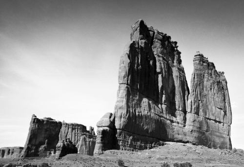 Visit Arches National Park in Utah and discover a landscape of contrasting colors, landforms and textures unlike any other in the world. The park has over 2,000 natural stone arches, in addition to hundreds of soaring pinnacles, massive fins and giant balanced rocks. This red rock wonderland will amaze you with its formations, refresh you with its trails, and inspire you with its sunsets.Courthouse Towers are pictured above.Photo: National Park Service
