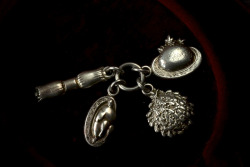 eriebasin:  19th Century English Victorian Christmas-Themed Charms, Sterling, (sold) I didn't immediately recognize these as Christmas themed.  It's interesting how symbolism changes. Nowadays Christmas charms would have other symbols— definitely a  tree and a little fat Santa at least.  Here we have a Christmas cracker, a turkey, mistletoe, and a Christmas pudding.