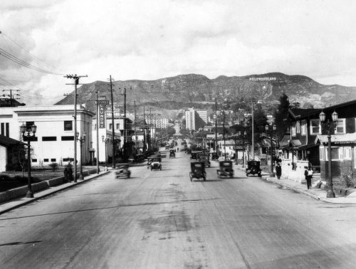 View looking north up Vine Street toward the the Hollywoodland sign, shortly after it was installed on the Santa Monica Mountains in 1923. As CurbedLA reports, the landmark recently underwent a nine-week restoration that required 255 gallons of paint. Part of the Title Insurance and Trust, and C.C. Pierce Photography Collection in the USC Digital Library.