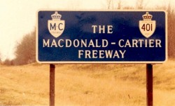 McDonald Cartier  In addition to the shields along the MacDonald-Cartier Freeway, there were also large blue signs installed at various points along the highway. These signs were introduced in 1965, and were phased out in the early 1980s. This is a picture of a blue MacDonald-Cartier Freeway sign, taken near Toronto International Airport in 1978: