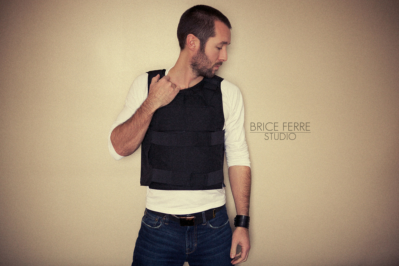 "When your client asks you to wear a vest like that for your shoot, you know you are about to have an interesting day. As I knew my mom was not really gonna love the idea of me having to wear a ""Stab Vest"" to work, I waited a bit before blogging about it. But I am now back in Vancouver so all is well. This type of vest is what the security men of Martyshuk Housing have to wear to work. It is designed to stop any punch, knife, baseball bat or crowbar. And it will also keep you seriously warm when you are working by -25 degrees. Working amongst the homeless community is an incredibly intense and rewarding job, but it has its risks as well. Most of the time Martyshuk Housing tenants are very calm and friendly, but sometimes, people are under the influence of drugs and/or alcohol and become agitated or violent. That's why the security team has to wear those vests when they are doing their rounds. Better safe than sorry. The fact is that a few of the security guards can attest, first hand, that those vest can stop a knife. Anyway, I flew back to Vancouver last night and I had an absolute blast with Martyshuk Housing's team. We shot a lot of interviews, security interventions, smiles, tears and various war stories. We'll start editing this very soon, as I can't wait to share the footage with you all. Email Us / Check my Portfolio / Follow me on Facebook / Follow me on Twitter / Follow me on Instagram /"