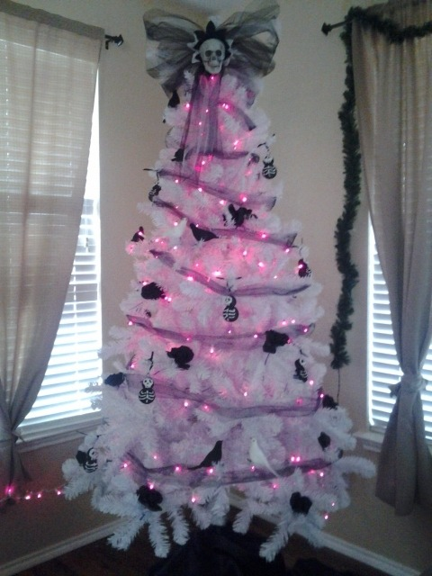 My tree!  Black roses, snowskellies, black and white birds, and skull topper.  All made by yours truly (;