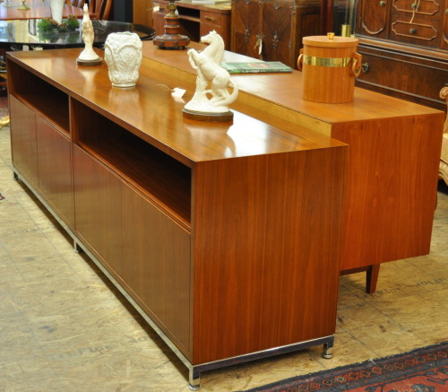 Credenza/entertainment unit. Quality teak/walnut unit. Quality construction. Understated elegance. Cabinet measures 8 feet in length and stands on a simple chrome base.