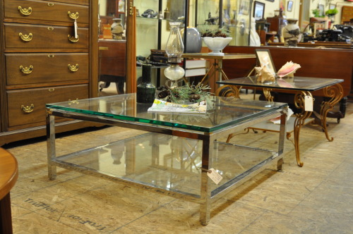 Chrome and glass coffee table. Quality modern design. Table has two 1/2 inch glass shelves. Showroom condition.