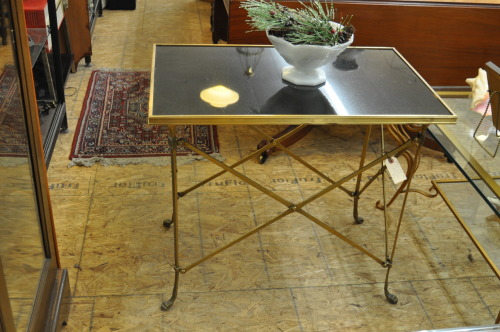 Highly detailed brass lamp table. Top surface appears to be made of black granite. Table is weighty and solid. Good design and quality construction.