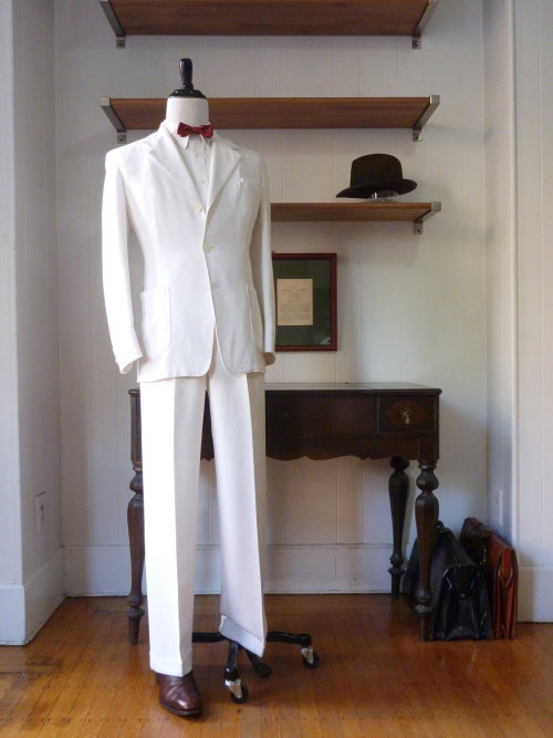 "1930s De Pinna white linen suit — Beyond the fact that this suit is nearly eight decades old, there's a story to go with it:  The man who gave me this suit told me that it belonged to his father. His father purchased it at the De Pinna department store on 5th Ave. in NYC. De Pinna is a now-defunct department store that was known for its high quality, conservative clothing and was owned (along with Brooks Brothers) by the parent company of Julius Garfinckel & Co. out of Washington D.C. Here is what the man recalls of the suit's history: ""On Friday June 28, 1940 my Father dressed in this linen suit and his best friend - both newly minted physicians - steamed away from Pier 32 in NYC on the American Republics Line S.S. Argentina bound for a great adventure to South America. For two months they ventured by ocean liner, train, private car, donkey and dugout to 'Rio, Sao Paulo (the Chicago of Brazil), Montevideo, Buenos Aires, the Great Lakes way to the south hidden amongst the Andes, Arequipa and the Quinta Bates, Cuzco and Macchu Picchu on the swift waters of the Urubamba, the myriads of flamingos resting on the shores of Lake Titicaca and Lima the 'City of Kings."" These were the days where each accommodation was preceded by a letter of introduction, one dressed for dinner, and the world unfurled before you.""  You don't really want to know how much it costs to own this suit, but it's definitely something to admire — especially being so clean after all these years."