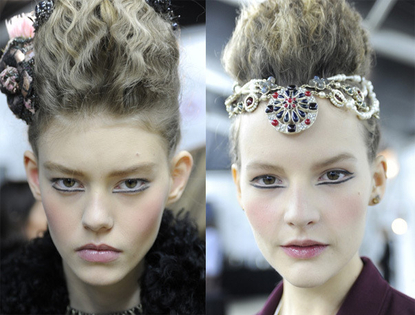 (Photo: beautyhigh.com) Sky-high Hair at Chanel Pre-Fall 2013, Pizza Hut's Fragrance, And More   For pre-fall 2013, models at Chanel got tall, teased, Elizabethan-style 'dos and crazy-cool graphic black liner. [Beauty High] How to choose the right concealer for your skin tone. [Beautylish]  Nails Inc. is bringing leather-textured manis stateside with their Bling It On Black Leather & Skulls nail set.  [SheFinds] Thanks to enthusiasm from social media, Pizza Hut is launching its own pizza-scented perfume. [Fashionista]  Gold leaf nails are a major trend right now. Here's how to create your own gilded mani with foil from a craft store. [BellaSugar] —Hallie   Once you've found the perfect concealer, be sure to use the right technique! Here's how to use Benefit Cosmetic's concealers to hide all your skin woes.