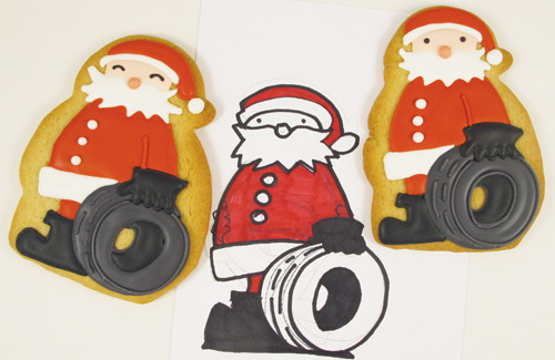 Santa with Tire artwork by David Morello. Cookie art by Laura at A Dozen Eggs Bake Shoppe.