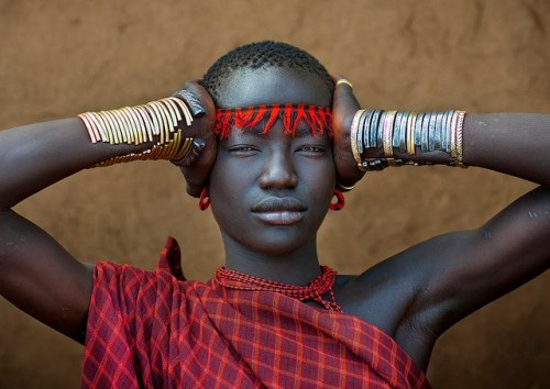 Bodi Tribe Woman With Headband, Hana Mursi, Omo Valley, Ethiopia. By: Eric Lafforgue.
