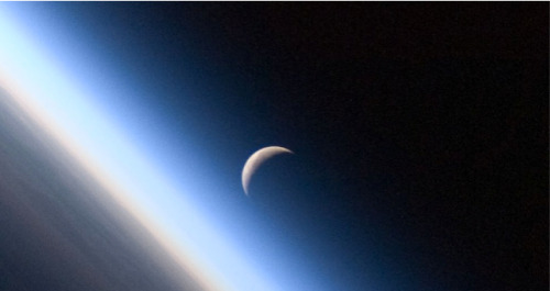 "sagansense:  Does the Moon Orbit the Sun or the Earth? image: NASA Everyone knows the moon orbits the Earth and that the Earth orbits the Sun. But what about the path of the moon around the Sun? What does that look like? I will go ahead and state that this is a difficult thing to show. Why? Scale, that's why. Let me give some values for the sizes of these things, then I will make some sort of diagram. Radius of the Sun: 6.95 x 108 m. Radius of the Earth: 6.38 x 106 m. Orbital radius of the Earth around the Sun: 1.5 x 1011 m. Radius of the moon: 1.7 x 106 m. Orbital radius of the Moon around the Earth: 3.48 x 108 m. Here is one attempt at drawing these three objects.  The objects all have the correct scale – but the Sun is in the wrong place (hopefully, this is obvious). The Earth and moon are the correct distance apart relative to their size. What about the Sun? In this diagram, the Earth and moon are about 11 cm apart (at least on my monitor). If you could see the whole Sun, it would be about 40 cm across. Where would the Sun be? You if you had a cut out of Sun, that piece of paper would have to be 43 meters off to the side. Yup. I said 43 meters. The sun is pretty far away. And this is the problem. How do you show the orbit of the Earth and moon around the Sun? You really can't, at least not to scale. Most textbooks end up making a plot where nothing is to scale. Here is something you might see.  It sort of works, right? It shows that the Earth orbits the Sun and the moon orbits the Earth. But what would it look like to scale? I am not sure what the best way to show this will be. Let me first assume perfectly circular orbits for both the moon and the Earth. I'm not going to show the Sun – here is just a part of their path.  This just shows half a month. If I wanted to show a longer time period, the motion of the Earth and moon around the Sun would make it super-difficult to see the motion of the moon relative to the Earth. Maybe it will help if I plot the distance from the Sun for both the Earth and the moon. Here is that plot over about 1 month.  You might notice that the distance from the Earth to the Sun changes. I put in an initial velocity to give the Earth a circular orbit. However, I also included the gravitational force on the Earth from the moon. This causes a bit of a wobble (but it isn't really important for this discussion). The real question that I want to look at is: does the moon orbit the Earth more or the Sun more? Which is more important? Let me try another plot. Here is the radial component of the acceleration of the moon over one month. Remember, from my last moon post we can break the forces (and thus the acceleration) into two types. There is a radial component that changes the direction of the momentum and a parallel component that changes the magnitude of the momentum. So, this is just the magnitude of the radial component.  But what does this even mean? Well, this says that no matter where the moon is in relationship to the Earth it has a radial acceleration in the direction of the Sun. It does not accelerate away from the Sun. If it did, it would have a negative radial acceleration component. Why does this look so similar to the radial position plot? Think of this. When the moon is on the far side of the Earth (so farther away from the Sun than the Earth is), it has both the Earth and the Sun pulling it towards the Sun. With this greater force comes a greater acceleration AND it is further away from the Sun. So, the plots look similar but they are not the same. Let me show this with a diagram (not to scale).  Here I have shown the gravitational force on the moon from the Sun is greater in magnitude than the gravitational force from the Earth. Is this actually true? To calculate this, I need to use the following model for the gravitational force:  This shows the magnitude of the gravitational force on the moon due to the interaction with the Sun. G is the gravitational constant (6.67 x 10-11 N*m2/kg2) and r is the distance between the Sun and the moon. Even though the moon moves around the Earth, this Sun-moon distance doesn't significantly change. If I use this gravity model, I can calculate the force per unit mass for an object in the location of the moon due to both the Sun and Earth. Gravitational force per mass due to the Sun = 0.00589 N/kg Gravitational force per mass due to the Earth = 0.00270 N/kg The Sun wins. But wait. How close would an object have to be for the gravitational force from the Earth to be greater? Here is a plot.  At an orbital distance of about 2.6 x 108 m, the force from the Earth and the Sun would be equal. This means that when an object was on the Sun side of it's obit, it would for a moment have a zero radial acceleration. For objects orbiting closer than this, the gravitational force from the Earth would be greater. This means that it would be accelerating towards the Earth and not the Sun at some parts of the orbit. Two Answers There are really two questions here. Let me answer both of them. Does the moon orbit the Sun? I would say yes. The interaction between the Sun and the moon has a greater magnitude than that of the moon-Earth interaction. The moon moves around the Sun at the same time it moves around the Earth. Perhaps the best answer is to say the the moon interacts with both the Earth and the Sun at the same time. This is what we call ""physics"". I don't think you could say that the moon just orbits the Earth. How do you represent the path of the moon as it goes around the Sun? You don't? I don't know. How do you represent the scale of the solar system? Again, this is a tough problem. You really can't do it in a textbook, can you? If I had to make a recommendation, I would tell introductory astronomy textbooks to NOT draw that squiggly moon path diagram. I don't think that helps anyone understand anything important.  szemfelnyitó csillagászati cikk of the day - és még csak 00:04-van."