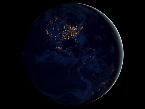 "Earth at Night  This new global view of Earth's city lights is a composite assembled from data acquired by the Suomi National Polar-orbiting Partnership (NPP) satellite.  Credit: NASA's Earth Observatory/NOAA/DOD  The data was acquired over nine days in April 2012 and 13 days in October 2012. It took 312 orbits to get a clear shot of every parcel of Earth's land surface and islands. This new data was then mapped over existing Blue Marble imagery of Earth to provide a realistic view of the planet.  The image was made possible by the satellite's ""day-night band"" of the Visible Infrared Imaging Radiometer Suite, which detects light in a range of wavelengths from green to near-infrared and uses filtering techniques to observe dim signals such as city lights, gas flares, auroras, wildfires and reflected moonlight.  The day-night band observed Hurricane Sandy, illuminated by moonlight, making landfall over New Jersey on the evening of Oct. 29. Night images showed the widespread power outages that left millions in darkness in the wake of the storm."