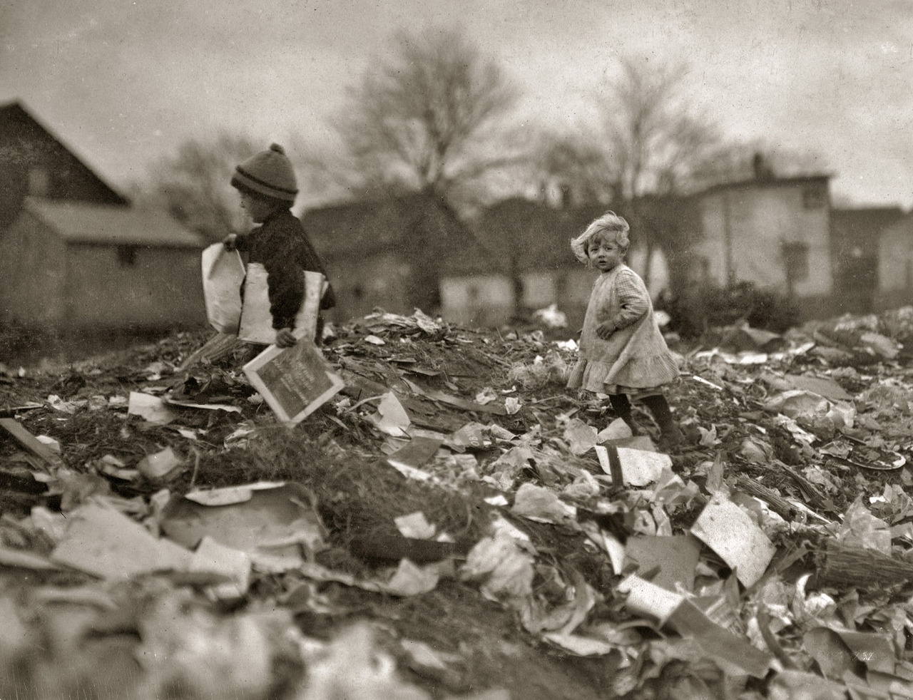 """Children going through Whitman Street dump. Pawtucket, Rhode Island."" November 1912. (via)"