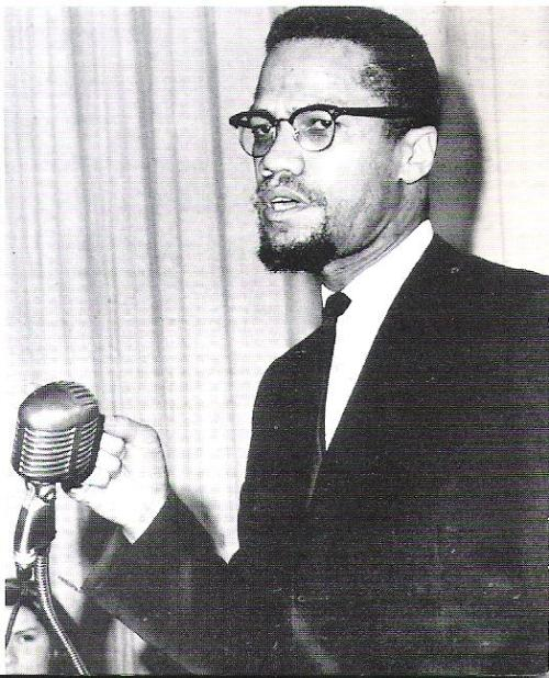 "disciplesofmalcolm:  disciplesofmalcolm:  Malcolm X at his last formal speech, at Barnard College, February 18, 1965. ""It is incorrect to classify the revolt of the Negro as simply a radical conflict of black against white or as a purely American problem. Rather, we are today seeing a global rebellion of the oppressed against the oppressor, the exploited against the exploiter."""