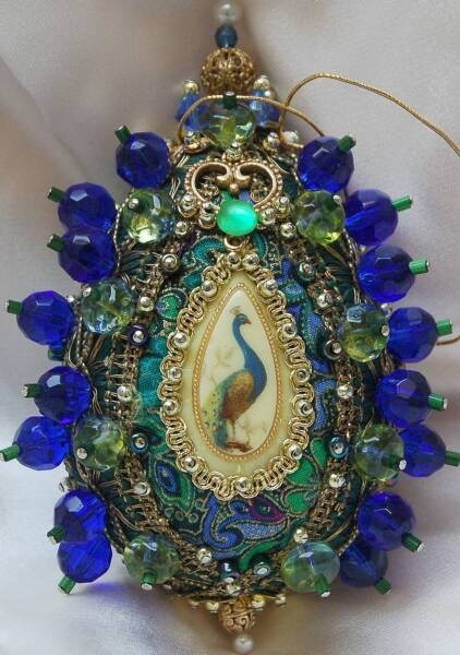 Handmade beaded Chriistmas peacock ornament.