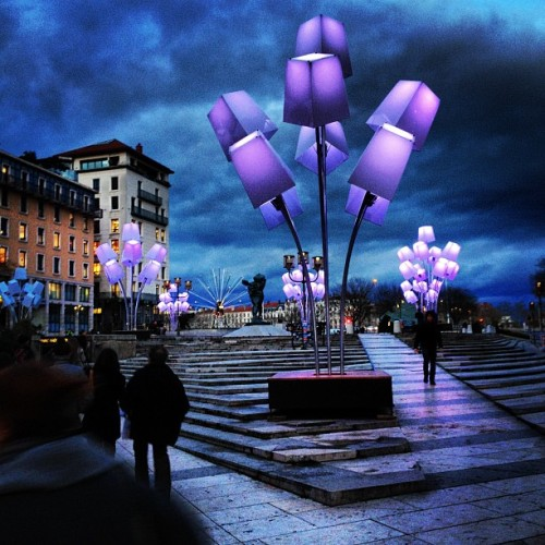 instagram:  Millions Drawn to Lyon's Fête des Lumières Want to see more dazzling luminescent art? Visit the #fêtedeslumières & #fdl2012 hashtag pages. Fête des Lumières, or the Festival of Lights, takes place in Lyon, France, every year around December 8th for four days. The Festival of Lights is the most popular event in Lyon, drawing crowds of several million into the city's illuminated streets each year. It includes over 80 lighting scenes all across the city of Lyon including the Place de la République, Place Bellecour, Place des Terreaux, Marches de la Guillotière, & the Place de la Bourse. The celebration unveils the architectural treasures of the city in a beautiful and unique way. Fête des Lumières' origins date back to 1643 when the inhabitants of Lyon were struck by the plague and spared. During the outbreak, the city council promised to pay tribute to the Virgin Mary should she save them, so every year on December 8th candles were lit and offerings were given in her name. The tradition of families placing burning candles on windowsills is still observed today, in addition to the extravagant and professionally run light performances.  It's the only thing I miss about Lyon…