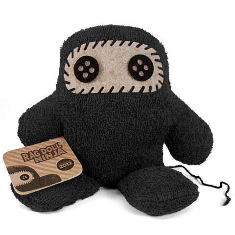Final Ninja of the Month: Ragdoll Ninja Shawnimals is moving onto new projects in their Legends of Ninjatown series, so December 2012's Ninja of the Month will be the final one produced by the company. And since this 7x7 inch plushy is closing the book on a three year long legacy, they've done something special with the Ragdoll Ninja. The terrycloth-like fabric, button eyes, and thick stitching make Ragdoll Ninja unique. And unlike other Ninjas, this one can sit upright, making it perfect for a shelf or table. He comes with the customary hangtag, card, and button, as well as a special scroll. Order one of the 100 handmade Ragdoll Ninjas from Shawnimals for $30.