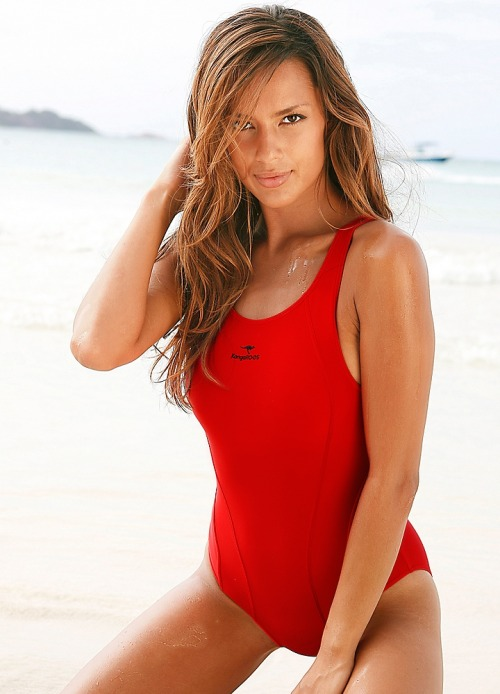 KangaROOS Red Sporty Swimsuit If you're looking for a fabulously sporty red swimsuit with a racer back and great support this is the perfect option. The elasticated under bust and extra chest lining provide great control so you can have peace of mind during your early morning jog on the beach or diving in the pool.
