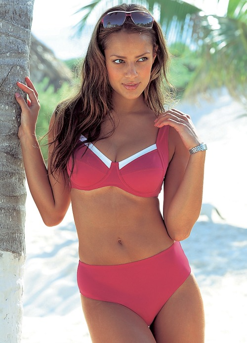 LASCANA Red Chest-Trim Bikini Stylish red bikini that has been designed to be both stylish and figure-friendly. A contrasting trim flows across the cups and leads up to the adjustable wide straps that offer superior support. Fitted with figure shaping power material, this particular swimwear style comes with briefs that cover the tummy but are also cut high on the hip.