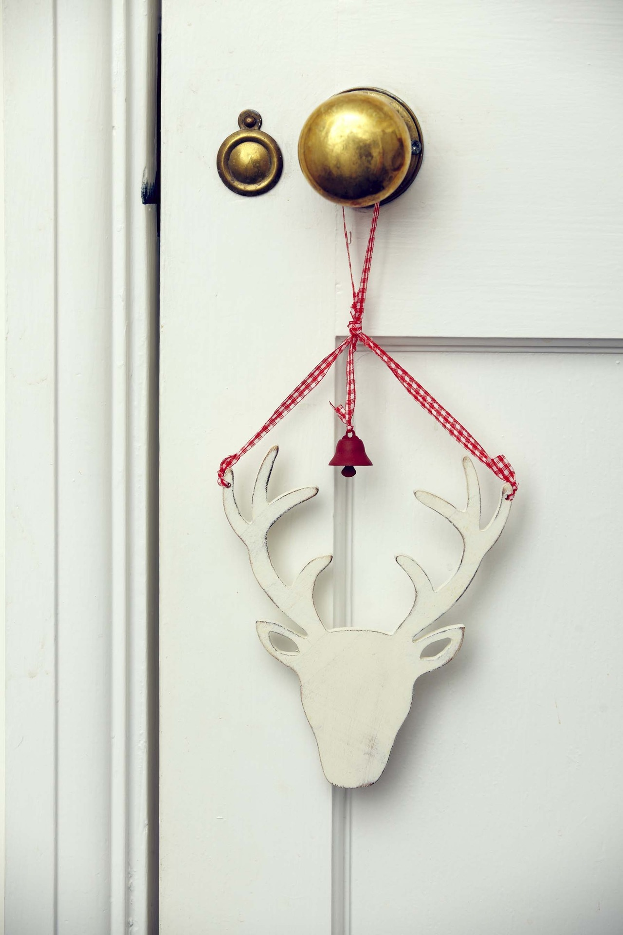 Our White Reindeer Head with Bell. Also available in natural.
