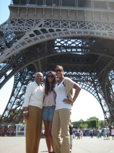 Three generations outside of the Eiffel Tower.