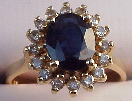 Princess Diana's engagement ring. Instead using diamond as the centre piece, she used a blue sapphire, which is very unique indeed. However, please keep in mind that a high quality blue sapphire is more expensive than the diamond of the same carat and same grade. Consider using this idea to design your own engagement ring if your girlfriend is a big fan of Princess Diana.