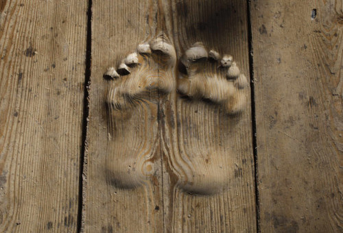 Footprints carved in wood.  Tibet's Great Prayer Festival - The Big Picture - Boston.com